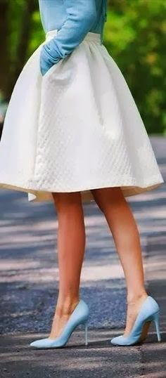 this outfit looks exactly like one I had for my Barbie doll so many years ago...right down to the pointy blue pumps!