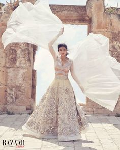 RHAPSODY IN WHITE. #SonamKapoor is sheer poetry in #AbuJaniSandeepKhosla Couture. The ghagra is a divine meld of elements including mirror, swarovski crystals, resham and bugle beads, on a pure white canvas of gossamer-like organza. A skin net blouse is the perfect jewel to complement it. Ethereal Style captured in the June/July edition of Harpers Bazaar Bride India