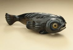 Pilot Fish netsuke. Japan, 19th century - Black persimmon wood with inlays | LACMA Collections