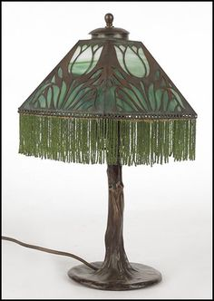 Handel Lamp; Not crazy about the shade, but love the tree trunk base