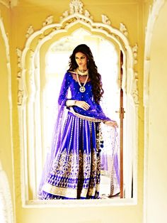Royal blue being the colour of the season makes this lehenga very popular. Its embroidery is again inspired by the Jantar Mantar architecture.  This  raw silk lehenga can be paired with a raw silk bandi and a beautiful net dupatta. This lehenga can also be paired with a royal blue brocade choli.