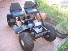 The beginnings of a golf cart modified to an off road vehicle.