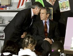 September 11, 2001, 9:05 am. President George W. Bush being told by Chief of Staff Andrew Card about the second plane hitting the World Trade Center while in a classroom at Emma Booker Elementary School in Sarasota, Florida.