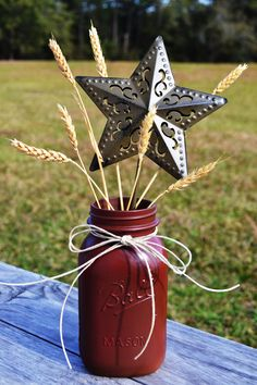"""Would you consider this """"redneck chic""""? lol @Sam Taylor March (just with a few flowers maybe) Rustic Centerpiece :) Simple with the wheat instead of flowers!!!!"""