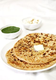 Aloo paratha recipe with step by step photos - a paratha stuffed with spicy potato mixture. A popular Punjabi or North Indian breakfast. Veg Recipes, Indian Food Recipes, Vegetarian Recipes, Cooking Recipes, Delicious Recipes, Yummy Food, Comida India, Paratha Recipes, Puri Recipes