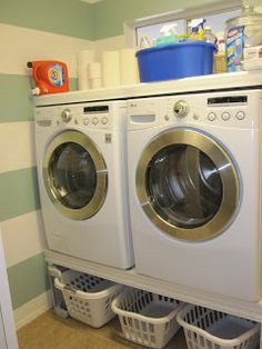 I love how they are raised to put baskets of dirty clothes under them :) Doesn't make your laundry room feel so small.
