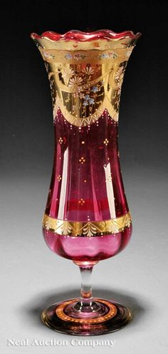 "*MOSER ~ Gilt and Enameled Cranberry Glass Vase, Late 19th - 20th Century, flared scalloped lip, waisted body, applied floral decoration, signed, stemmed base, height 12 1/4""."