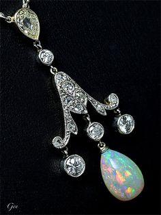 An Edwardian platinum, gold, diamond and opal pendant necklace, English, circa 1910.