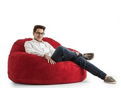 The Fuf Cloud 9 suede bean bag is made for today's living rooms, bedrooms and family rooms. Gone are the days of flat, shapeless bean bags—this resilient seating is filled with a patented shredded foam that can be re-fluffed again and again, so the bean bag always remains soft, supportive and comfortable. And with a durable chain-stitched suede cover, the bean bag can handle anything your family dishes out.