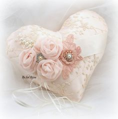 """9 x 8"""" ring-bearer pillow $105; The pillow features a string of pearls, along with the ribbon to tie the rings. The back of the pillow has an ivory satin band across, which it perfect for carrying. This heirloom accessory is 9 x 8 inches. The matching flower girl basket is also available $120"""
