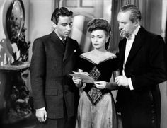 """Peter Lawford, Donna Reed and George Sanders - supporting cast in """"The Picture of Dorian Gray"""", 1945."""