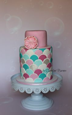 Double barrel cake with scales pattern and flower.