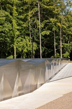 The studio also tried to give it the appearance of an object that has been semi-excavated from the ground below. Exhibition Building, Exhibition Space, Zaha Hadid Design, Rose Garden Design, Timber Structure, Meadow Flowers, Zaha Hadid Architects, Deciduous Trees, Light Installation