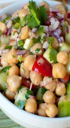 1 15-oz can of garbanzo beans (chickpeas) 1 1/2 cups peeled and diced English cucumber 1 1/2 cups diced tomatoes 1 jalapeno, seeds and pith removed, finely diced 1/2 cup finely diced red onion 1/2 cup cilantro, minced 2-3 tablespoons minced basil 2-3 tablespoons minced mint 2 garlic cloves, mashed 1 teaspoon salt 2 tablespoons freshly squeezed lemon juice 1 teaspoon Dijon mustard 2 teaspoons rice vinegar 3 tablespoons extra virgin olive oil freshly ground black pepper