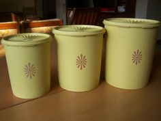 Vintage Tupperware Canisters 1970s Pale yellow with brown sunburst design - Set of 3 with lids by RetrowareExchange on Etsy