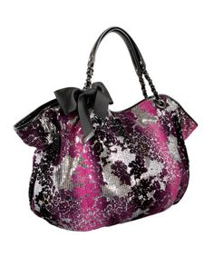 I love Betsey Johnson handbags, because I don't wear bold prints often, but by simply adding one of her bags, you can make the outfit that much better.  LOVE HER!