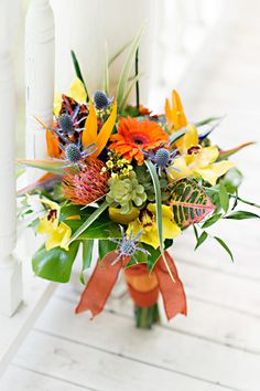 My fiancés favorite flower is Bird of Paradise. If you think we can fit one in my bouquet and it won't totally stand out or look weird, that would be nice. If not, no biggie.