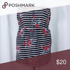 161259 Mixed Striped & Floral Strapless Baby Doll This top pairs a floral print with navy and white nautical inspired stripes, with a babydoll silhouette that takes your figure to the spectacular now. In a lightweight and silky-soft black challis, the style has a smocked back that lends stretch and comfort to your every move.  Strapless Twin front hip pockets Mock button bodice Allover mixed floral and striped print Torrid size 3 - Fits 22/24. Torrid Tops