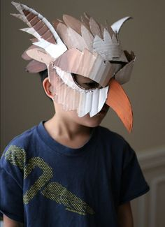 DIY Cardboard Box Mask I could use this idea to make the raven masks from foam and felt: