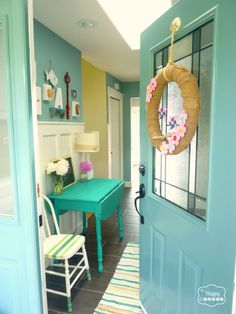 Colorful Lake House tour filled with tons of great DIY ideas!  If I ever own a beach house or vacation home THIS is how I would decorate! So fun!