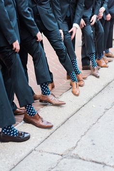 Navy and white polka dot socks: http://www.stylemepretty.com/louisiana-weddings/new-orleans/2016/10/03/modern-colorful-new-orleans-destination-wedding/ Photography: Julie Paisley - http://juliepaisley.com/