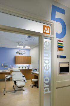 """Concentra solicited design services from Little due to the firm's retail experience, which yielded a medical office that uses pictograms and oversized exam room numbers to guide patients in a bright, fun, yet relaxing atmosphere, as seen in this procedure room in a Charlotte, N.C., location that opened in 2008. """"If you're 5 or 95, you're going to see room number 5,"""" says Daniel Montaño. """"You can't miss it."""" Photo: Mark Steele."""