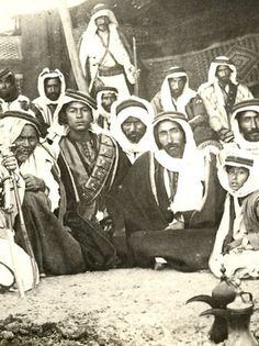 Photograph of a group of armed Bedouins, during the Syrian Revolt, 1925-27, against the French Mandate.The group,young and old gathered next...