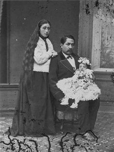 Rare to see the women hair down,death photo. The flowers were use to mask the odor of death