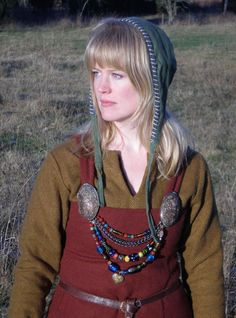 very accurate representation of traditional icelandic/viking women's attire. attached to belt would also be small tools for use in daily chores - scissors, knife, small pouches etc.