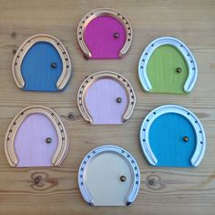 A blank canvas of horseshoe fairy doors. Now my favourite bit.....the decoration!