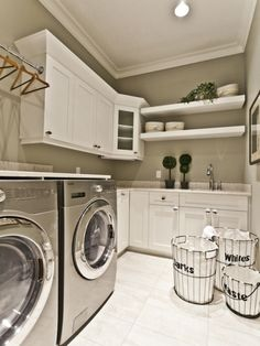 Laundry with hanging racks for shirts, multiple baskets for sorting laundry, overhead cupboards for chemicals, medicines