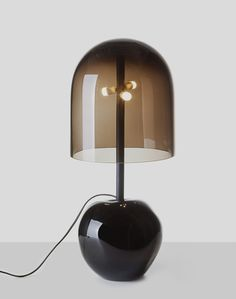 Table lamp with smoked glass shade by DECHEM Studio