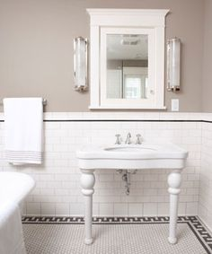 Historic reproduction Subway tile for the walls and Unglazed porcelain hexagons for the floor. Notice the dark grout and border on the floor, black pencil trim on the wainscoting.