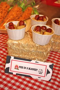Pigs in a Blanket (in a cup, filled partially with ketchup for Farm / Barnyard Party-- Poppy Event Design. PERFECT FOR SMALL HANDS!