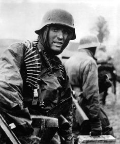 Among the most famous of the photos taken by German military cameramen during the Ardennes Offensive, is this shot of a soldier from Kampfgruppe Hansen (Leibstandarte Division) posing for the camera, after the action with American 14th Cavalry Group on the road between Poteau and Recht, 18 December 1944.