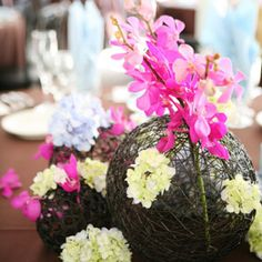 Reinvented Centerpiece Vessels    Ditch the standard table, vase and flower combo and have your florist place stems into one of these balls of twine for a more rustic look.