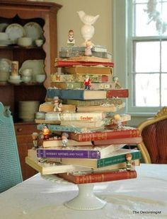 Centerpiece with books and figurines.