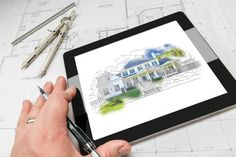 Hand of Architect on Computer Tablet Showing Kitchen Illustratio
