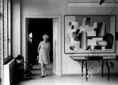 Peggy Guggenheim in her house. Venezia Pinned this in Alexander Calder, for the mobile hanging in this picture!