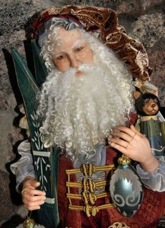 Santa by Audrey Kander Swarz.  Audrey also sculpts fabulous dolls.