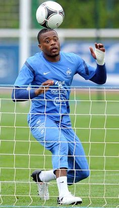 French national football team  defender Patrice Evra heads the ball during a training session, on May 22, 2012 in Clairefontaine, outside Paris, as part of France's preparation stage for the Euro 2012.