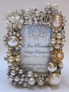 Precious small faux pearl and rhinestone frame designed with vintage earrings and rhinestone bits & baubles. Holds a 2 x 3 photo; overall 3.5 x 4.5. $40