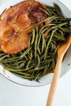 Southern Style One-Pot Green Beans Recipe.Lots of comfort foods from the south are EASY like this delicious, healthy, low carb side dish. Perfect if you're looking for ideas for side dishes for dinner! You'll need garlic, ham steak, cloves, onion, chicken broth, and green beans.