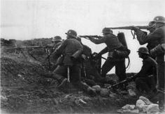 Wehrmacht soldiers assault team in a battle on the outskirts of Leningrad. Soldiers armed with two machine guns MG-34 and knapsack flamethrower Flammenwerfer 35