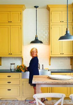 Wow! Yellow kitchen cabinetry, tall ceilings, white brick... so different! Love it all!