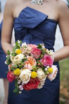 Gorgeous bouquet.  The colors pop against the blue dress!  Bouquet by Sayles Livingston.