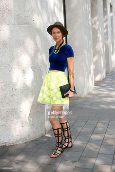 Jewellery designer Imogen Belfield is wearing an American Apparel top, Karen Millen skirt, Kurt Geiger shoes and Imogen Belfield jewellery on day 1 of London Collections: Women on September 12, 2014 in London, England.