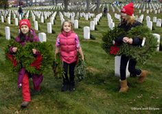 Young volunteers carry wreaths to graves at Arlington National Cemetery during a Wreaths Across America event on December 15, 2012. (JOE GROMELSKI/STARS AND STRIPES) #military #DC #Arlington #children #SOT