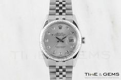 Men's Rolex Stainless Steel Silver Diamond Dial Fluted Bezel Datejust