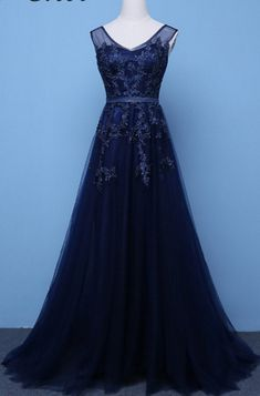 A long evening gown, formal wedding dress and